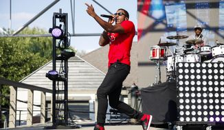 """In this July 19, 2014, file photo, Christian rapper Lecrae performs at the Rock the Island Christian Music Festival on Ojibway Island,in Saginaw, Mich. Last month, his seventh album, """"Anomaly,"""" became the first title to top Billboard's Top 200 and Gospel Album charts in the same week. He believes this success could help bring him closer to being embraced by both gospel and mainstream music. (AP Photo/The Saginaw News, Neil Barris/File)"""