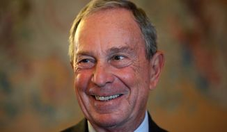 In this Tuesday, Sept. 16, 2014, file photo, former New York Mayor Michael Bloomberg smiles prior to be conferred with the Chevalier de la Legion d'Honneur by France's Foreign minister Laurent Fabius, at the Quai d'Orsay, in Paris. (AP Photo/Thibault Camus, File)