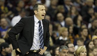 Cleveland Cavaliers head coach David Blatt yells at his team during a preseason exhibition basketball game against Maccabi Tel Aviv Sunday in Cleveland. (AP Photo/Mark Duncan)