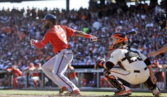 Washington Nationals center fielder Denard Span (2) connects for a base hit in the second inning of Game 3 of baseball's NL Division Series against the San Francisco Giants in San Francisco, Monday, Oct. 6, 2014. (AP Photo/Ben Margot)