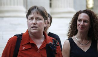 Kate Burns, left, one of the plaintiffs who challenged Colorado's 2006 voter-approved gay marriage ban, responds to questions during a news conference in Denver as attorney Mari Newman looks on after the U.S. Supreme Court declined Monday to hear appeals from several states seeking to ban same-sex marriage. (AP Photo/David Zalubowski)