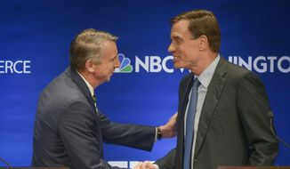 The candidates shake hands before the Fairfax County Chamber of Commerce hosts Virginia's U.S. Senate Debate between Democratic U.S. Sen. Mark Warner, right, and Republican challenger Ed Gillespie on Tuesday, Oct. 7, 2014 in McLean, Va. (AP Photo/The Washington Post, Bill O'Leary, Pool)