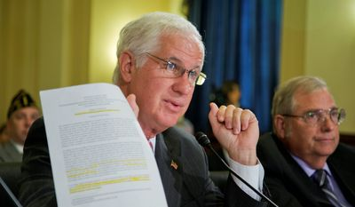 """Department of Veterans Affairs Acting Inspector General Richard Griffin, left, with Retired Medical Director of the Diamond Community-Based Outpatient Center, Phoenix VA Health Care System, Veterans Health Administration Samuel Foote, holds documents as he testifies during a House Committee on Veterans' Affairs hearing on """"Scheduling Manipulation and Veteran Deaths in Phoenix: Examination of the OIG's Final Report"""" on Capitol Hill in Washington, Wednesday, Sept. 17, 2014. (AP Photo/Manuel Balce Ceneta) ** FILE **"""
