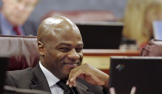 In this May 19, 2005, file photo, Sen. Kelvin Atkinson, D-Las Vegas, listens to testimony during a Government Affairs committee meeting at the Nevada State Legislature in Carson City, Nev. Atkinson says he proposed to his partner immediately after hearing that an appeals court had overturned the state's ban on same-sex marriage. (AP Photo/Nevada Appeal, Brad Horn, File)
