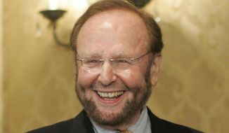 In this May 25, 2005, file photo, of Tampa Bay Buccaneers team owner and owner of Manchester United Malcolm Glazer smiles at the announcement of Tampa Bay being awarded the 2009 Super Bowl, during the NFL's Spring Meetings at the Ritz-Carlton Hotel in Washington.  The FBI investigated threats of violence made against Malcolm Glazer and his family around the time the late owner of the Tampa Bay Buccaneers was acquiring English soccer club Manchester United, according to newly released documents. (AP Photo/J. Scott Applewhite, File)