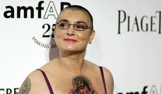 FILE - In this Oct. 27, 2011 file photo, Irish musician Sinead O'Connor arrives at amfAR's Inspiration Gala in Los Angeles. O'Connor is working on a memoir that will come out in March 2016, Blue Rider Press announced Tuesday, Oct. 7, 2014. The book is currently untitled. (AP Photo/Matt Sayles, File)
