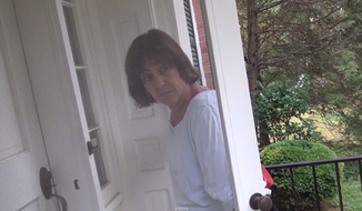 Lois Lerner doesn't appear to be making any friends in her upscale Bethesda, Maryland, neighborhood. In a video published Tuesday, the embattled ex-IRS director is seen trying to flee from a reporter into the home of a neighbor, who is less than thrilled to see her. (YouTube/Daily Surge)