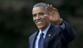 President Barack Obama waves as he walks across the South Lawn of the White House in Washington, Tuesday, Oct. 7, 2014, to board Marine One for a short trip to Andrews Air Force Base, Md., before traveling to New York. (AP Photo/Carolyn Kaster)