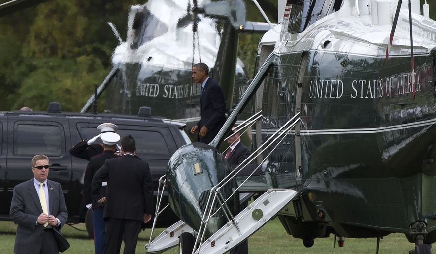 President Barack Obama walks off Marine One after arriving for a fundraiser, on Tuesday, Oct. 7, 2014, in Greenwich, Conn. Obama is traveling to New York and Connecticut for Democratic fundraisers. (AP Photo/Evan Vucci)