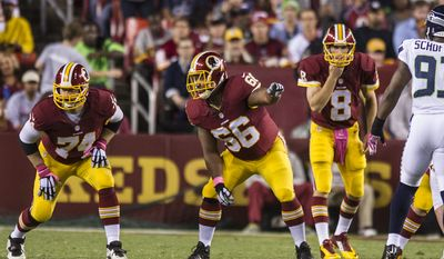 Washington Redskins guard Chris Chester (66) calls out directions to tackle Tyler Polumbus (74) before the snap against the Seattle Seahawks at FedExField, Landover, Md., Oct. 6, 2014. (Preston Keres/Special for The Washington Times)