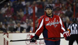 Washington Capitals defenseman Matt Niskanen (2) skates during a break in the action in the second period of a preseason NHL hockey game against the Buffalo Sabres, Sunday, Sept. 21, 2014, in Washington. (AP Photo/Alex Brandon)