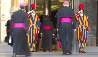 Bishops arrive Tuesday Oct. 7, 2014, at a morning session of a two-week synod on family issues at the Vatican. Pope Francis has urged bishops to speak their minds about contentious issues like contraception, gays, marriage and divorce at the start of the meeting aimed at making the church's teaching on family matters relevant to today's Catholics. (AP Photo/Alessandra Tarantino)