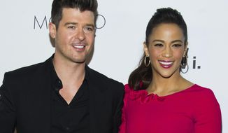 "FILE - In this Wednesday, Oct. 23, 2013 file photo, Robin Thicke and Paula Patton attend the sixth annual GQ Gentlemen's Ball in New York. Patton has filed for divorce from Thicke and is asking for joint custody of their son. Patton filed in Los Angeles on Friday, Oct. 3, 2014, citing ""irreconcilable differences."" (Photo by Charles Sykes/Invision/AP, file)"