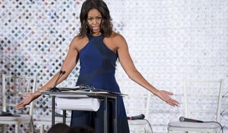 First lady Michelle Obama speaks at the Fashion Education Workshop, Wednesday, Oct. 8, 2014, in the East Room of the White House in Washington.   (AP Photo/Manuel Balce Ceneta)