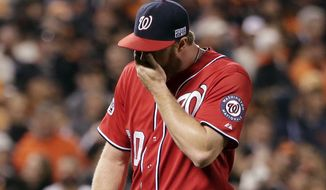 Washington Nationals pitcher Aaron Barrett (30) walks off after giving up a run on a wild pitch in the seventh inning against the San Francisco Giants during Game 4 of baseball's NL Division Series in San Francisco, Tuesday, Oct. 7, 2014. (AP Photo/Marcio Jose Sanchez)
