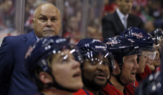 Washington Capitals head coach Barry Trotz stands in the bench area in the third period of a preseason NHL hockey game against the Buffalo Sabres, Sunday, Sept. 21, 2014, in Washington. The Capitals won 1-0. (AP Photo/Alex Brandon)