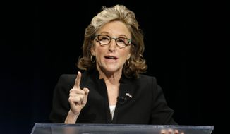In this Oct. 7, 2014, photo, Sen. Kay Hagan, D-N.C., makes a comment during a live televised debate with North Carolina Republican Senate candidate Thom Tillis at UNC-TV studios in Research Triangle Park, N.C. (AP Photo/Gerry Broome, Pool)
