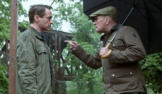 """The Judge,"" featuring Robert Downey Jr. (left) and Robert Duvall, is neither a terrific movie nor a terrible one, though at various times it flirts with being both. (Associated Press)"