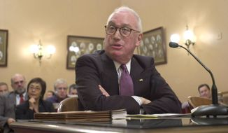 In this Wednesday, July 10, 2002 file photo, Michael Peevey, Gov. Gray Davis' appointee to the Public Utilities Commission, answers questions while appearing at his confirmation hearing before the Senate Rules Committee at the Capitol in Sacramento, Calif. Peevey, California's chief utility regulator, under fire over accusations of secret dealings with the state's largest utility, said Thursday, Oct. 9, 2014 that he will not seek reappointment when his term ends at the end of the year. (AP Photo/Rich Pedroncelli, File)