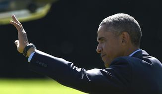 President Barack Obama waves as he walks to Marine One on the South Lawn of the White House in Washington, Thursday, Oct. 9, 2014, for a short trip to Andrews Air Force Base, Md., then onto California for three days. (AP Photo/Susan Walsh)