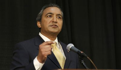 Incumbent Democratic Rep. Ami Bera, speaks during a debate with Republican challenger Doug Ose, for California's 7th Congressional District seat in Sacramento, Calif., Wednesday, Oct. 8, 2014. Bera and Ose debated subjects including health care, water and the problems in the Middle East. (Associated Press)