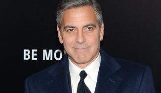 """Director/actor George Clooney made an appearance at New York Comic Con on Oct. 9 for a panel on his upcoming film, """"Tomorrowland."""" (Photo by Evan Agostini/Invision/AP, File)"""