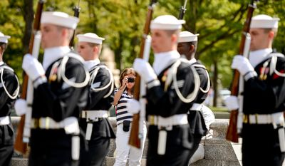 United States Navy Ceremonial Guard march together during a wreath laying ceremony to celebrate the Navy's 239th birthday at the United States Navy Memorial, Washington, D.C., Thursday, October 9, 2014. (Andrew Harnik/The Washington Times)