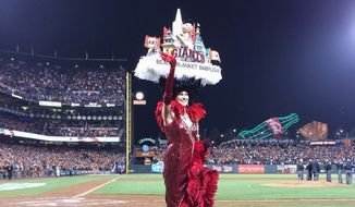 Beach Blanket Babylon cast member Caitlin McGinty, singing during the 7th inning stretch of the playoff game between the San Francisco Giants and the Washington Nationals. Photo credit: Beach Blanket Babylon/ Facebook