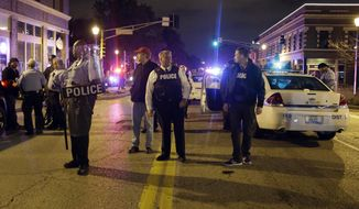 St. Louis Police Chief Sam Dotson, center, stands in the middle of the street with other officers during a confrontation between protesters Thursday, Oct. 9, 2014, a day after Vonderrit D. Myers was shot and killed by white, off-duty St. Louis police officer in St. Louis. (AP Photo/Jeff Roberson) ** FILE **