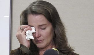 "Cylvia Hayes, fiancee of Oregon Gov. John Kitzhaber, cries as she speaks at a news conference in Portland, Ore. on Thursday, Oct. 9, 2014. Hayes has admitted that she violated the law when she married an immigrant seeking to retain residency in the United States. She said she was ""associating with the wrong people"" while struggling to put herself through college and regrets her actions. (AP Photo/Gosia Wozniacka)"