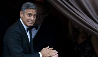 "In this Sept. 27, 2014, file photo, George Clooney arrives at the Aman hotel in Venice, Italy. Clooney made an appearance at New York Comic Con, Thursday, Oct. 9, 2014, for a panel on his upcoming film, ""Tomorrowland.""  (AP Photo/Andrew Medichini) ** FILE **"