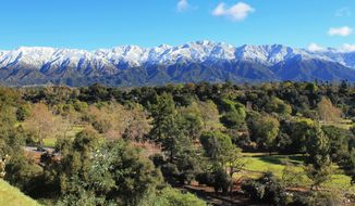 In this Feb. 20, 2011, photo, the San Gabriel Mountains rise above Pasadena, Calif., with the Brookside Golf Course in the foreground. (AP Photo/John Antczak) ** FILE **