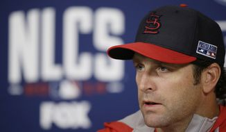 St. Louis Cardinals manager Mike Matheny speaks to the media, Friday, Oct. 10, 2014, in St. Louis. The St. Louis Cardinals and San Francisco Giants are scheduled to start the National League Championship Series on Saturday in St. Louis. (AP Photo/Charlie Neibergall)