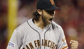 San Francisco Giants starting pitcher Madison Bumgarner reacts after striking out St. Louis Cardinals' Tony Cruz during the seventh inning in Game 1 of the National League baseball championship series Saturday, Oct. 11, 2014, in St. Louis. (AP Photo/Jeff Roberson)