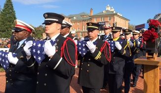 People attend the national memorial ceremony for fallen firefighters in Emmitsburg, Md., Sunday, Oct. 12, 2014. (AP Photo/PennLive.com, Ivey DeJesus) ** FILE **