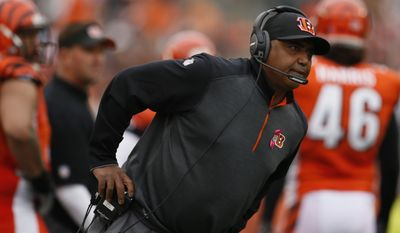 Cincinnati Bengals head coach Marvin Lewis works on the sidelines in the second half of an NFL football game against the Carolina Panthers, Sunday, Oct. 12, 2014, in Cincinnati. (AP Photo/Paul Sancya)