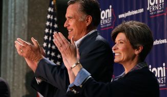 Former Republican presidential nominee Mitt Romney campaigns for Joni Ernst at Iowa Farm Bureau Headquarters in West Des Moines, Iowa, Sunday, Oct. 12, 2014. Ernst is in a close race with Bruce Braley for the U.S. Senate seat being vacated by Tom Harkin. (AP Photo/The Register, Mary Willie)