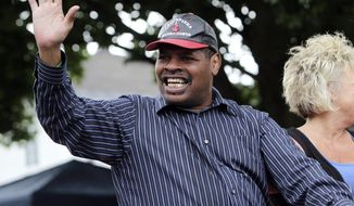 FILE - In this June 12, 2011, file photo, former heavyweight boxing champion Leon Spinks waves during a Boxing Hall of Fame parade in Canastota, N.Y. Leon Spinks is in a Las Vegas hospital after a second operation for abdominal problems. The 61-year-old boxer who catapulted to fame by beating Muhammad Ali in 1978 had the second surgery in recent days after complications from the first emergency surgery. (AP Photo/Mike Groll, File)