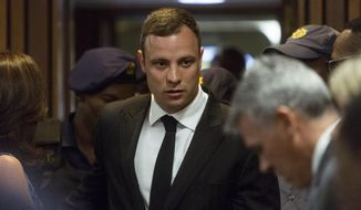 Oscar Pistorius arrives in court Monday, Oct. 13, 2014 to face sentencing for the shooting death of his girlfriend Reeva Steenkamp. Pistorius was found guilty last month on a culpable homicide charge. The defense have started arguing in mitigation of sentence. (AP Photo/Marco Longari. Pool)