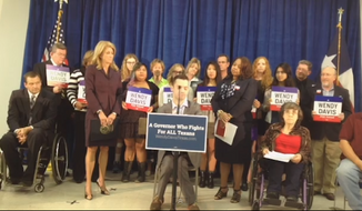 "Texas Democratic gubernatorial candidate Wendy Davis appears at a press conference on October 13, 2014 to defend her controversial ""wheelchair"" ad against opponent Greg Abbott (screenshot via The Daily Caller)."