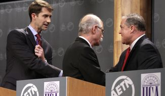 Republican candidate for U.S. Senate U.S. Rep. Tom Cotton, R-Ark., left, greets Democratic incumbent U.S. Sen. Mark Pryor, far right, as Green Party candidate Mark Swaney walks past after a televised debate at the University of Central Arkansas in Conway, Ark., Monday, Oct. 13, 2014. (AP Photo/Danny Johnston)