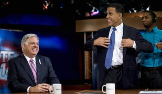 Maryland gubernatorial candidates Republican Larry Hogan, left, and Democrat Maryland Lt. Gov. Anthony Brown have a laugh before the Maryland gubernatorial debate at News Channel 8 in Arlington, Va., Monday, Oct. 13, 2014. Brown and Larry Hogan spent much of their second debate trading accusations and focusing on weaknesses. (AP Photo/The Washington Post, Melina Mara, Pool)