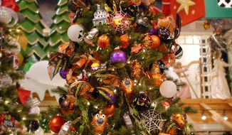 This undated image released by Bronner's Christmas Wonderland shows a Halloween-themed tree displayed at Bronner's Christmas Wonderland, a large Christmas store in Frankenmuth, Mich. So-called holiday creep, where the traditions one special occasion are embraced by another, now extends to Halloween. (AP Photo/Bronner's Christmas Wonderland)