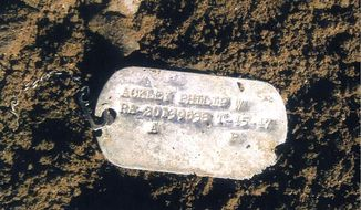 """This undated file photo provided on July 14, 2010, by the U.S. Defense Dept. shows Pfc. Philip W. Ackley's Korean War dog tag. The tag, which was found in North Korea's Unsan battlefield area where Ackley is believed to have been lost, was handed over to the U.S. by North Korean at the Panmunjom truce village in January, 2010. North Korea said Monday, Oct. 13, 2014, that the remains of American soldiers killed during the Korean War were being neglected and """"carried away en masse,"""" in an apparent effort to pressure Washington to resume recovery efforts that could also lead to much-needed money for the impoverished country. (AP Photo/U.S. Defense Dept., File)"""