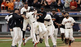San Francisco Giants' Gregor Blanco celebrates after hitting the game winning bunt during the 10th inning of Game 3 of the National League baseball championship series against the St. Louis Cardinals Tuesday, Oct. 14, 2014, in San Francisco. (AP Photo/Jeff Chiu)