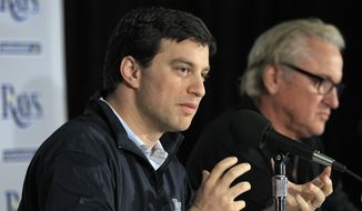 Andrew Friedman left, Tampa Bay Rays executive vice-president of baseball operations, gestures as he sits with manager Joe Maddon during a season wrap-up news conference Thursday, Oct. 6, 2011, in St. Petersburg, Fla. The Rays lost to the Texas Rangers during baseball's American League division series. (AP Photo/Chris O'Meara)