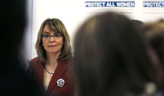 "Former Arizona Rep. Gabby Giffords listens to a speaker during a roundtable discussion on the first stop of her ""Protect All Women"" tour in Portland, Maine, Tuesday, Oct. 14, 2014.  Giffords, who was severely wounded in a 2011 shooting that killed six in Tucson, is seeking to elevate the issue of gun violence against women on state and federal levels. (AP Photo/Charles Krupa)"