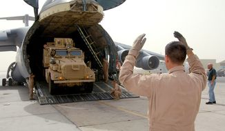 A Mine Resistant Ambush Protected vehicle (MRAP) is unloaded from a C-5 Galaxy on Sept. 25, 2008 at an air base in Southwest Asia. (Image: U.S. Air Force)