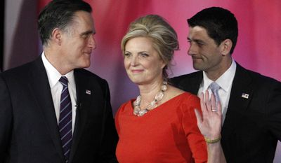 FILE - In this Nov. 7, 2012, file photo, Republican presidential candidate and former Massachusetts Gov. Mitt Romney, left, speaks to his running mate, vice presidential candidate, Rep. Paul Ryan, right, R-Wis., as Romney's wife Ann waves to supporters after Romney conceded the race during his election night rally in Boston. Romney and his wife Ann announce an initiative to accelerate treatment and cures for complex neurological diseases, in partnership with Boston's Brigham and Women's Hospital. (AP Photo/Stephan Savoia, File)
