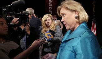 Sen. Mary Landrieu, D-La., talks to the media after her debate with Senate candidate Rep. Bill Cassidy, R-La., and Republican candidate Rob Maness at Centenary College in Shreveport, La., Tuesday, Oct. 14, 2014. (AP Photo/Gerald Herbert)